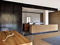 Wood and iron apartment by Luca Compri architetti