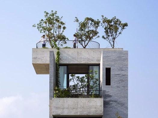 Casa binh terrazze e balconi alberi e calcestruzzo for Arredamento terrazze e balconi